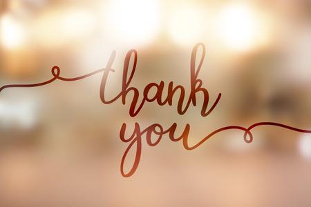 A thank you, lettering on golden blurred background of lights Illustration