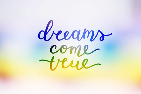 A dreams come true, lettering on rainbow blurred abstract background Ilustração