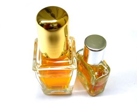 whiff: Top view of two Perfume bottles