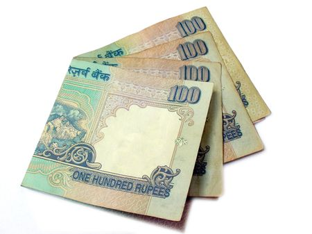 Indian Bank Notes-100 Rupee notes isolated and in an arrangement on white