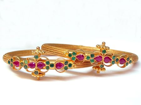 A couple of gold bangles on white  Stock Photo