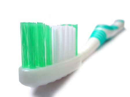 A Closeup view of Tooth brush on white