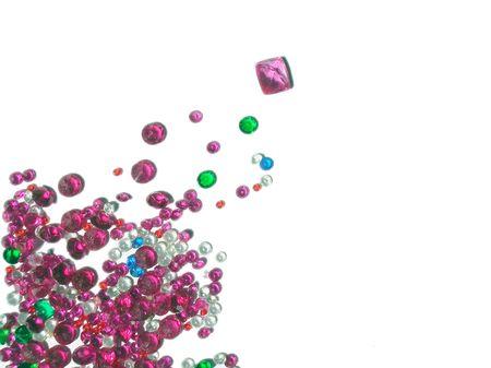 an assortment of polished semi-precious stones on white photo