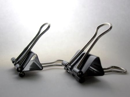 disorganize:            two Image of Metalic binder paper clips