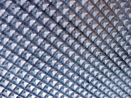 Texture produced by a pattern of  glass. Stock Photo - 2504335
