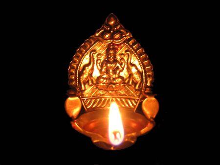 Lakshmi-Hindu goddess for wealth-Silver idol over black Stock Photo