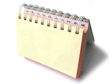 Top view of  Table top Daily planner on white