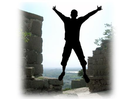 Freedom-Man with his arms wide open on top of hill  Stock Photo - 2657774