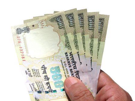 generosidad: Hand Holding dinero-moneda india