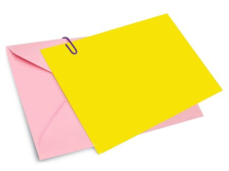 Pink envelope and  yellow card with paper clip Stock Photo
