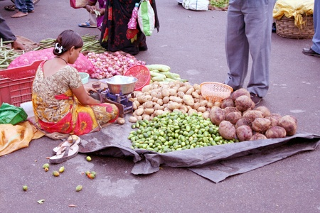 agriculture india: Hyderabad,AP,India-August 27,2011-Indian woman ,street vendor selling vegetables. Editorial