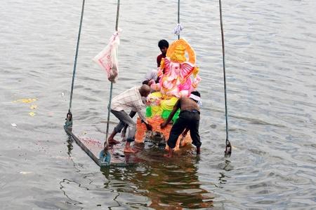 rituals: Hyderabad,AP,India-September 4,2011-Hindus immesing the Ganesh Idol  in lake during vinayaka chathurthi.