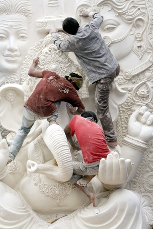 Hyderabad,AP,India-August 23,2011-Artists working on th ganesha idol for the Ganesh chathurthi festival. .