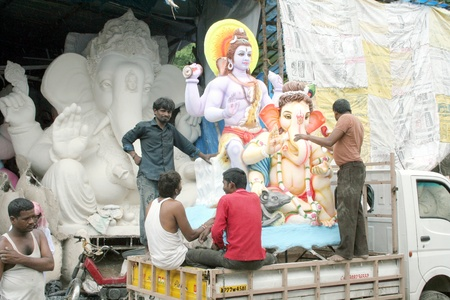plaster of paris: Hyderabad,AP,India-August 23rd,2011-Ganesha idol being transported fo installation in pandal during gansh chathurthi , Editorial
