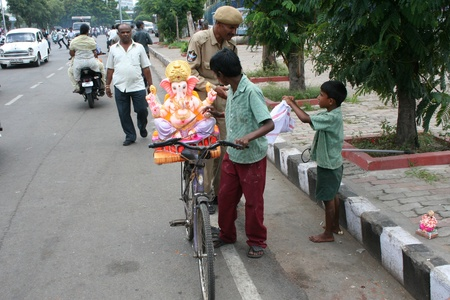 Hyderabad,AP,India-September 12,2011-Young boys being helped by security person  for Ganesh Immersion,during Gansh Chaturthi,on the tankbund