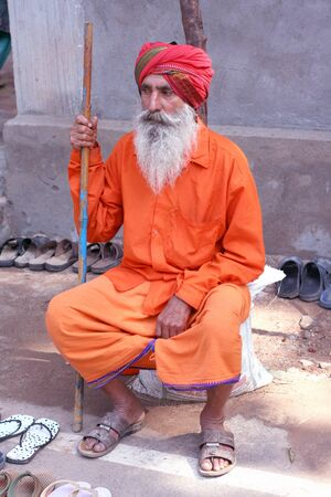 Hyderabad,AP,India-September 12th,2011-Indian Sadhu sitting infront of hindu temple