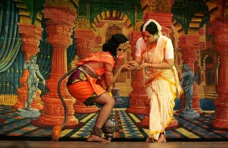 ramayana: Hyderabad,Ap,India-May 15,2012-Dr G Padmaja Reddy of Pranav Institute of kuchipudi dance with students performs Ramayana dance ballet to non stop chanting of Hanuman Chalisa on Hanuman Jayanthi day. Editorial