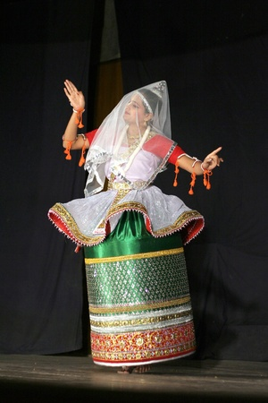 Hyderabad,Ap,India-April 08,2012- Smt.savanabrata sircar performs Manipuri dance,a major form of indian classical dance originated in Early 15th century,  during Naatya tarang event.  Stock Photo - 13686313