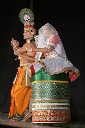 indian classical dance: Hyderabad,Ap,India-April 08,2012- Smt. and sri. savanabrata sircar performs Manipuri dance,a major form of indian classical dance originated in Early 15th century,  during Naatya tarang event.