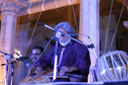 shri: Hyderabad,Ap,India-April 18,2012- Pt.Vishwa Mohan Bhatt, Hindustani classical musician with a grammy award, Performing at Chowmahalla Palace built in 1869 by Nizams of Hyderabad state during heritage week celebrations.