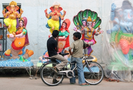 hyderabad: Hyderabad,Ap,India- September 02,2012:Children looking at Ganesh idols kept for sale during hindu festival ganesh chathurthi .Thousands of idols are made every year.
