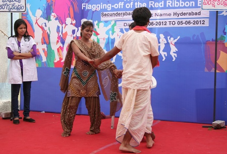 Secunderabad,Ap,India-June 05,2012-Local artists perform street play, on visit of Red Ribbon Express to Secunderabad,an Indian Railways AIDSHIV awareness campaign.