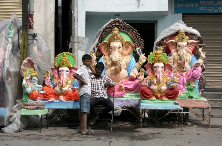 Hyderabad,AP,India- September 1,2013-Children looking at Ganesha idols kept for sale during hindu festival ganesh chathurthi  Thousands of idols are made every year