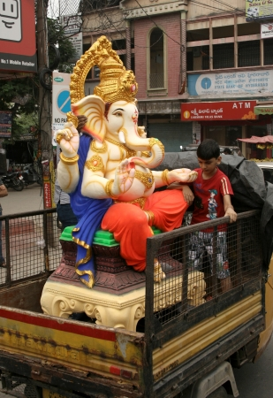 Hyderabad,AP,India- September 13, 2013- People transport Ganesha idol for Hindu festival ganesha chathurthi to  perform 10 day puja in Thousands of neighbourhoods