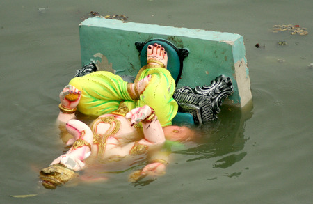 Hyderabad,Ap,India- September 15,2013-Ganesha idol float after immersion, during hindu festival  Every year pollutants are removed immediately after immersion