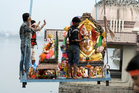 Hyderabad,Ap,India- September 19 People use crane to lift Lord Ganesha idol for the traditional immersion during Hindu festival ganesh chathurthi