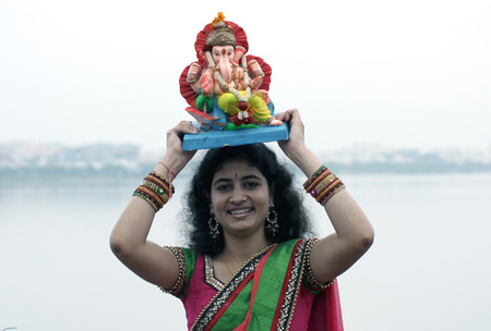 immersion: Hyderabad,Ap,India- September 18,2013-Hindu devotee bring Lord Ganesha idol for the traditional immersion in Hussain sagar during Hindu festival ganesh chathurthi