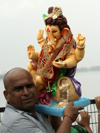 Hyderabad,Ap,India- September 18,2013-Hindu devotee bring Lord Ganesha idol for the traditional immersion in Hussain sagar during Hindu festival ganesh chathurthi