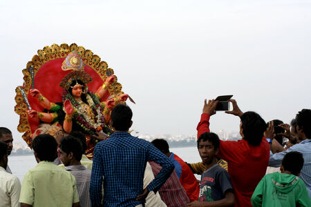 shakti: Hyderabad,Ap,India-October 12,2013 -Hindu devotess perform puja before immersing Durga as the final ritual of 9 day long Navratri festival This is an annual event