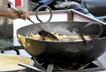 make public: Hyderabad,Ap,India-January 12,2014-Indian street vendor make mirchi bajji in a public place  Popular snack in india