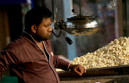 make public: Hyderabad,Ap,India-January 12,2014-Indian street vendor make popcorn in a public place  Popular snack in india  Editorial