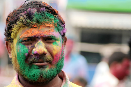 hindus: Hyderabad,India-March 6,2015:Hindu man celebrating Holi, or festival of colors,annual Popular festival for Hindus and non-Hindus in most parts of the world.