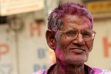 hindus: Hyderabad,India-March 6,2015:Hindu old man celebrating Holi, or festival of colors,annual Popular festival festival for Hindus and non-Hindus in most parts of the world.