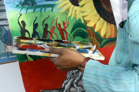 hyderabad: Hyderabad,India-February 15,2015:Artist painting in necklace road on happy streets day (vehicular traffic stopped 6-10 AM). Editorial