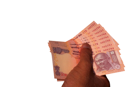 indian currency: Indian Currency Bank notes  INR 10 in the hand