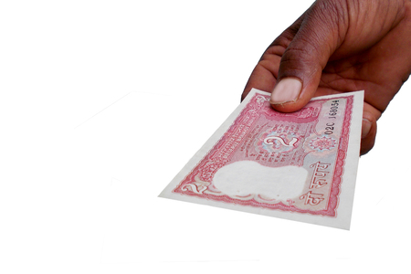 indian currency: Indian Currency Bank note INR 10 in the hand Stock Photo