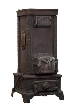 Beautiful antique stove with bull-head motive photo