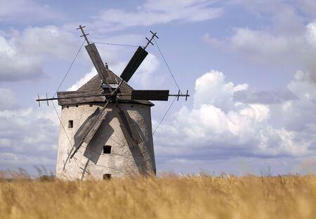 Windmill in a grain field photo