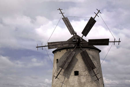 Windmill detail with blue cloudy sky photo