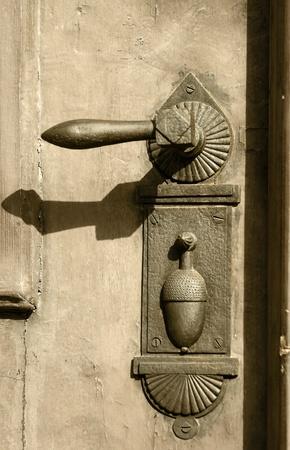 Old rustic metal door handle photo
