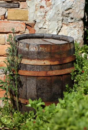 Old wood cask in front of a brick wall Stock Photo - 13900047