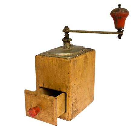 Isolated antique grinder on white background photo