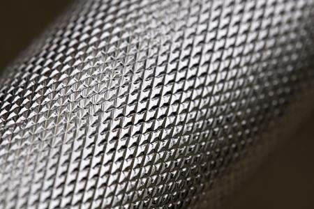 Geometrical pattern on a shiny metal rod photo