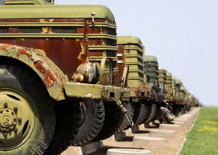 A group of old military vehicles photo