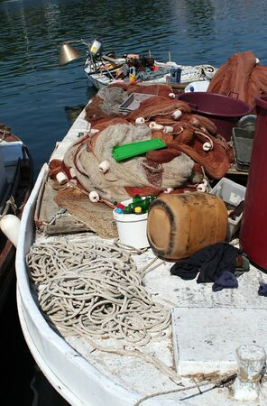 A messy fishing boat with equipments photo