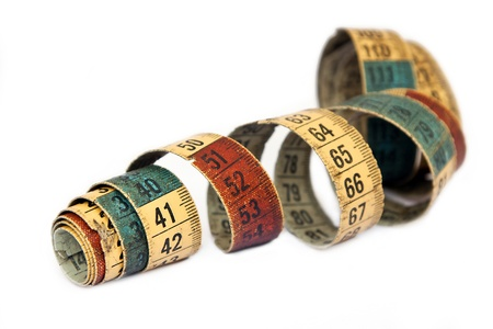 Old tape measure on white background Imagens